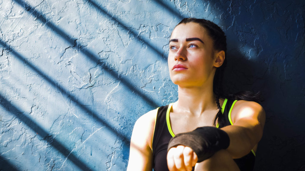 woman thinking after a martial arts workout.