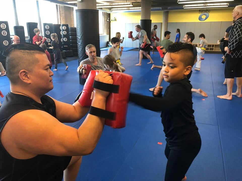 dad and kids practicing martial arts