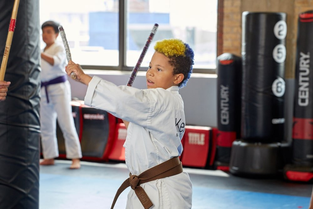 Child practicing filipino martial arts