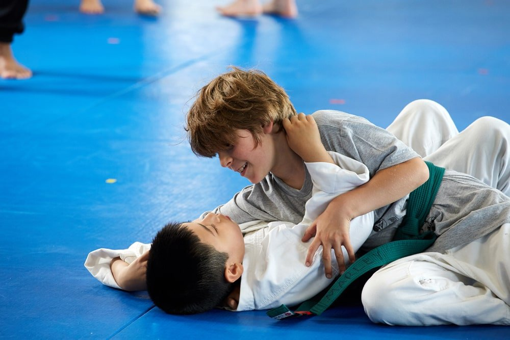 Child practicing grappling and jiu-jitsu