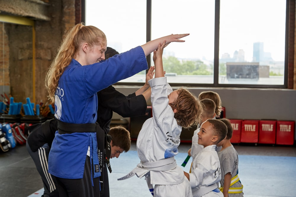 high fives in karate class